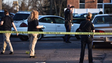 Investigators at the scene of the shooting in the area