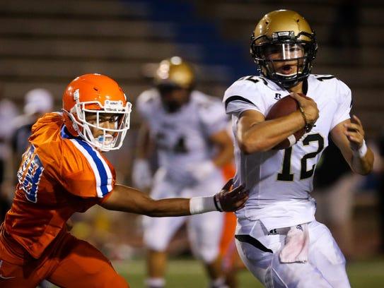 Central's Nick Severson chases down Abilene High quarterback