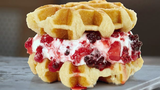 Eat your red, white and blue by indulging in BurgerFi's Very Berry Wafflewich featuring vanilla custard and tropical berry jam in between two sugar-glazed waffles.