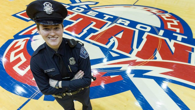 Detroit Police Officer Abby Campbell, 24, poses for a portrait on Monday, Feb. 13, 2017 at University of Detroit Mercy. Officer Campbell is being awarded by her alma mater before the men's basketball game for First Responders' Night this Friday, Feb. 17, for helping talk a man down from jumping onto the John C. Lodge earlier this year. Elaine Cromie/Detroit Free Press