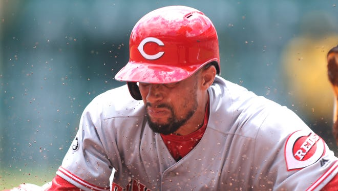 Cincinnati Reds center fielder Billy Hamilton (6) steals third base against the Pittsburgh Pirates during the first inning  at PNC Park.