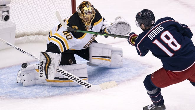 Boston's Tuukka Rask makes a save on Columbus center Pierre-Luc Dubois during the first period of Thursday's exhibition game.