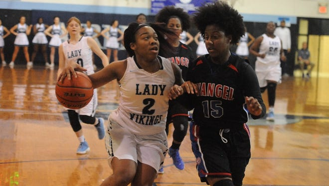 Airline's Taaliyah Johnson drives against Evangel's Meagan Laboy during Friday's game at Airline.