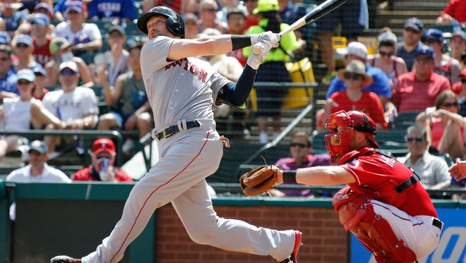 Arlington, TX, USA; Boston Red Sox right fielder Bryce Brentz (64) hits a home run in the sixth inning against the Texas Rangers  at Globe Life Park in Arlington.
