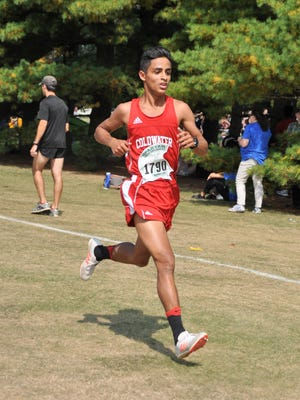 Coldwater High School senior Shuaib Aljabaly runs at the MSU Spartan Invitational on Sept. 15, 2017.