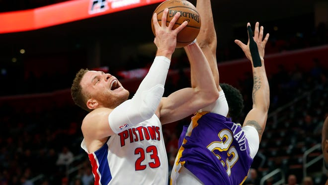 Pistons forward Blake Griffin drives on Pelicans forward Anthony Davis in the first half Monday, Feb. 12, 2018 in Detroit.