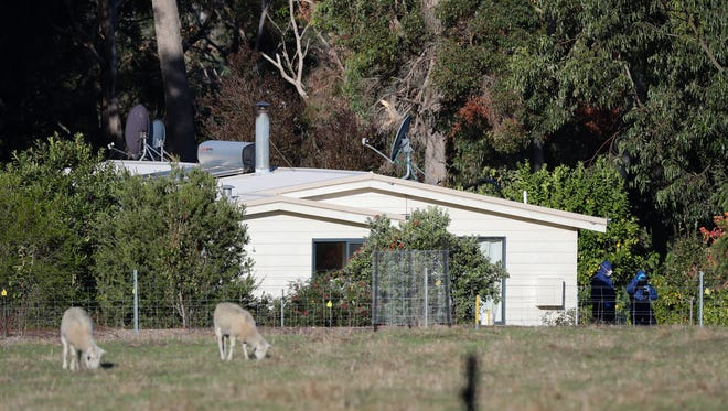 Police forensics investigate the death of seven people in  Osmington, Australia, May 11, 2018. Four children are among the dead.
