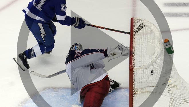 In this Aug 19, 2020, file photo, Tampa Bay Lightning center Brayden Point (21) shoots to score a goal against Columbus Blue Jackets goaltender Joonas Korpisalo (70) during the overtime period in game five of the first round of the 2020 Stanley Cup Playoffs at Scotiabank Arena.