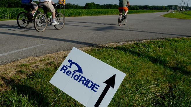 Cyclists participate in the seventh annual ReidRide Saturday, July 18, 2015, in Richmond. The ride hosted by Reid Hospital raises money to provide shoes for kids.