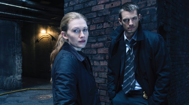Sarah Linden (Mireille Enos) and Stephen Holder (Joel Kinnaman) in a scene from 'The Killing.'