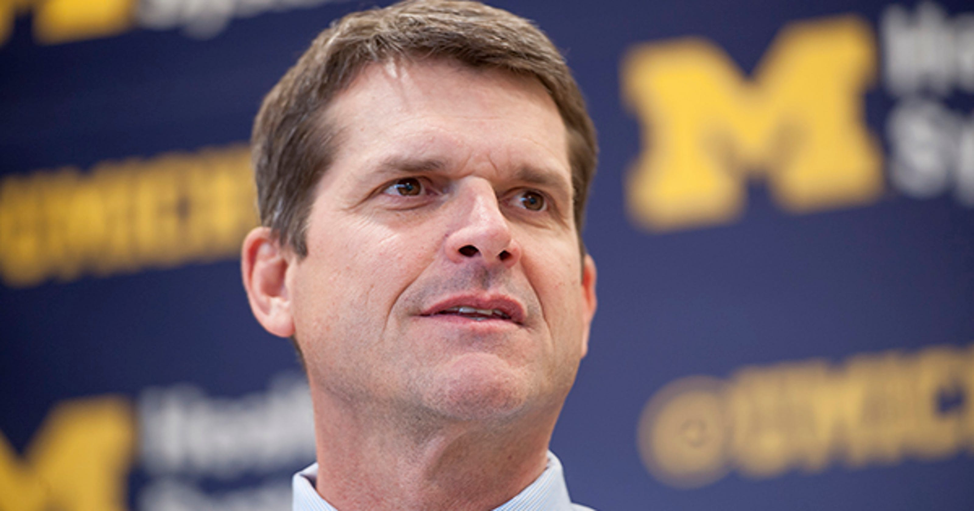 4b2c5abdda Jim Harbaugh joins Michelle Obama at education event