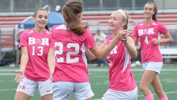 Bridgewater-Raynham's Cassie Tofteroo (22) is shown here in this 2017 photo, scoring the winning goal as teammates congratulate her. Tofteroo won the Taunton Daily Gazette Player of the Week honor for Oct. 12-16.