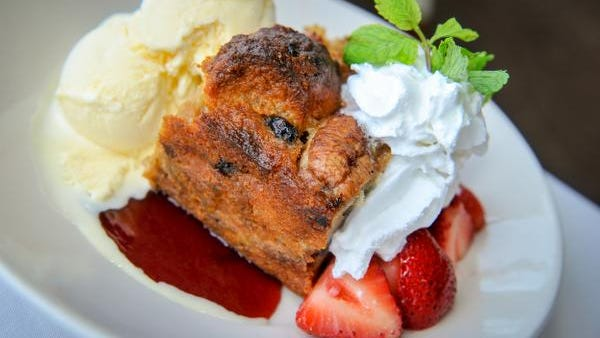 Bread Pudding with vanilla ice cream strawberries, whipped cream and raspberry sauce at Rooney's Oceanfront Restaurant  in Long Branch.