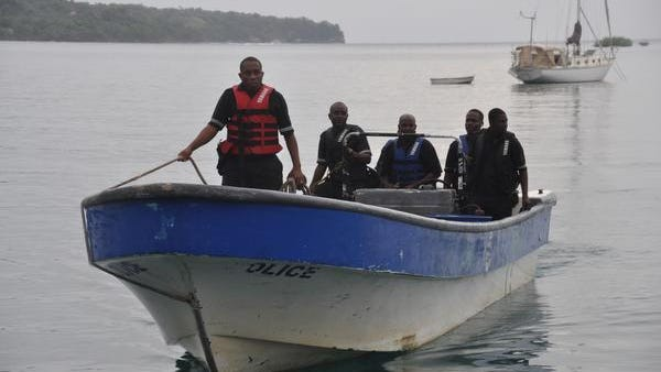 Jamaican Marine Police return to the Port Antonio Marina after a fruitless search for a plane that crashed into the ocean near Port Antonio, Jamaica, on Friday. A small plane flew down the Atlantic Coast and beyond Friday before finally crashing in the waters off Jamaica.