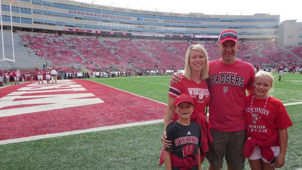 Ella Bindl, right, was photographed with her family at the Wisconsin Badgers game on Sept. 20, in which she was a junior captain of the team and got to participate in the opening coin toss.