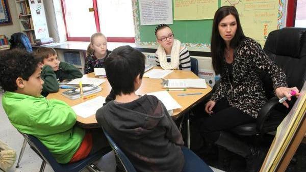 Fifth grade teacher Rebecca Coatti works with students Nicholas Lau, Rudy Arietta, Thomas Crable, Logan Feinberg and Melanie Meehan on a poetry lesson during English class at the Cottage Lane Elementary School in Blauvelt Jan. 23.