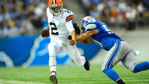 Cleveland Browns quarterback Johnny Manziel (2) is forced out of bounds by Detroit Lions linebacker Travis Lewis during the third quarter at Ford Field.