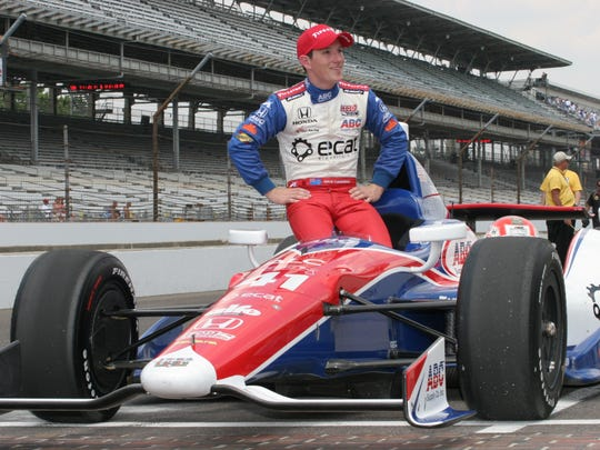 Wade Cunningham  posing for photos after making the field for the Indy 500 in 2012.