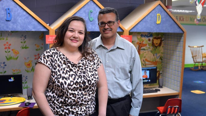 Magdalena Fernandez and her husband Misael Fernandez Jr., of Vineland, visit the  Vineland Public Library, where they donated a language learning center computer (right) in memorial to their son Julio Daniel Fernandez, who was lost to a miscarriage. ' I still have plenty of days and moments that hurt,' she says.