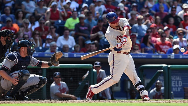 Aug 2, 2015; Philadelphia, PA, USA; Philadelphia Phillies catcher Cameron Rupp (29) singles to left field during the seventh inning of the game at Citizens Bank Park. The Atlanta Braves won the game 6-2. Mandatory Credit: John Geliebter-USA TODAY Sports