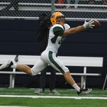 Staehling helping SNC football stretch field