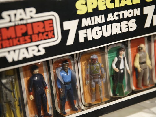 """Action figures from the """"Star Wars"""" movie series are displayed during a press preview at Sotheby's in New York on Dec. 2."""
