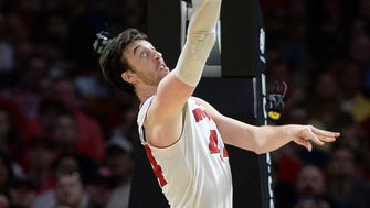 Mar 28, 2015; Los Angeles, CA, USA; Wisconsin Badgers forward Frank Kaminsky (44) moves to the basket against Arizona Wildcats during the second half in the finals of the west regional of the 2015 NCAA Tournament at Staples Center. Mandatory Credit: Richard Mackson-USA TODAY Sports ORG XMIT: USATSI-221706 ORIG FILE ID:  20150328_gav_am8_119.jpg