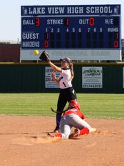 A Lubbock Coronado base runner slides into second base as Lake View's Elizabeth Lewis prepares to make the play during District 4-5A softball action Tuesday, March 21, at Maidens Field in San Angelo.
