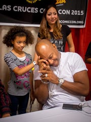 "Nine-year-old Dasani Clarke has an effect on one of last year's headlining guests, actor Tommy Lister, at the 2015 Las Cruces Comic Con. Afterwards Lister said, referring to his character from the film ""Friday"" and its sequels, ""Deebo met his match."""