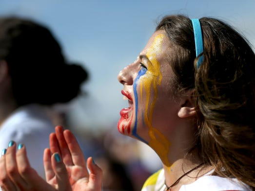 Valeria Moran joins with other Venezuelans and their supporters in Doral, Fla., on Feb. 22 to show their support for anti-government protesters in Venezuela.