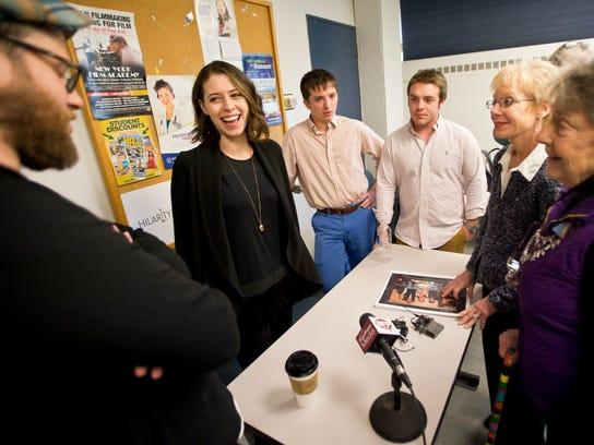 From left, Seth Rogen and Lauren Miller Rogen talk