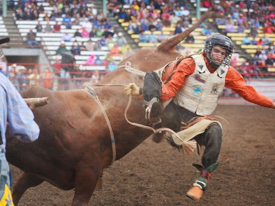 Logan Beckett, from Rapid City, South Dakota, prepares to land after his ride in the PRCA bull ride.