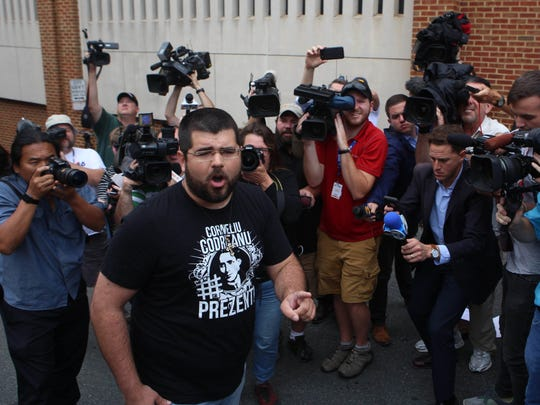 White nationalist Matthew Heimbach, 26, of Paoli, Indiana, yells Aug. 14, 2017, to television crews and reporters in Charlottesville, Virginia, about where to place the blame for the protests and death that occurred at a Unite the Right rally two days before.