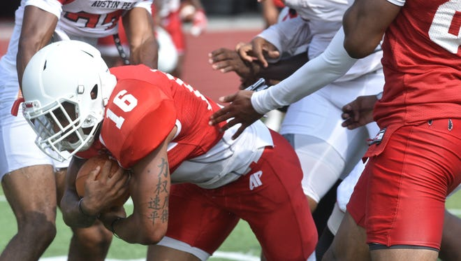 Daryl Rollins-Davis, a running back, tries to break through defenders during a drill at Austin Peay's fall camp on Aug. 10.