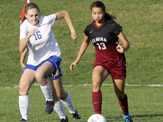 Kendra Oldroyd of Elmira controls the ball as Emily Leland of Horseheads defends during the teams' 1-1 girls soccer tie last season. Both players are back this season.