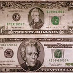 New in 1998, the design of the United States $20 bill, bottom, is seen with the old one at the Federal Reserve Bank of Philadelphia. Some critics of Jackson want him removed from the $20 bill in place of a woman.