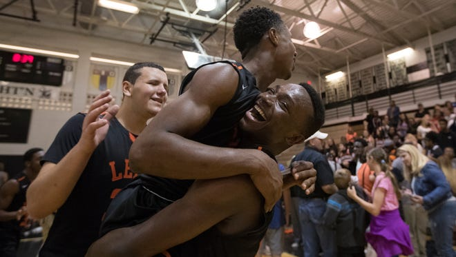 Lely's Olivier Dumel lifts teammate Rudge Hyppolite after defeating Mariner High School for the District 6A-12 championship Friday evening.