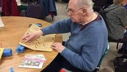 A local resident plays his cards during a recent in-person BINGO game at the Burlington Council on Aging. The games have now gone online due to the coronavirus.