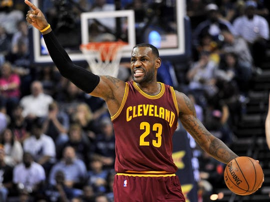 Cleveland Cavaliers forward LeBron James (23) calls to players in the first half of an NBA basketball game against the Memphis Grizzlies Wednesday, Oct. 28, 2015, in Memphis, Tenn. (AP Photo/Brandon Dill)