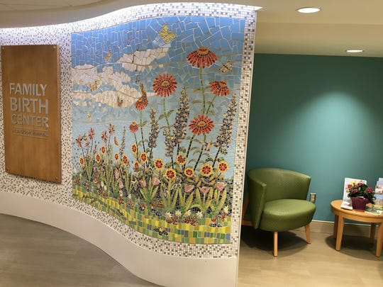 The mural at the entrance to Jackson Hospital's new birthing suites features a tile mosaic of a nature scene.