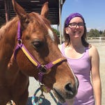 Brittany Miller recently became a volunteer at Happy Trails Riding Academy. The 21-year-old suffered a traumatic brain injury in 2012 after falling from her horse. Now, she hopes to inspire others through her volunteerism.
