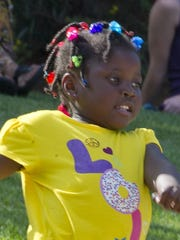 Four year old Rebekah Moore dances to the music of Kalamazoo based Reggae band Zion Lion which performed at Friendship Park Friday night as part of the Battle Creek Downtown Partnership's Vibe@5 concert series.