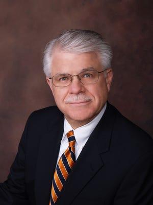 John E. Settle Jr.
