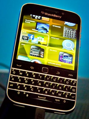 FILE - In this Wednesday, Dec. 17, 2014, file photo, BlackBerry's new BlackBerry Classic phone appears on display during a news conference, in New York. BlackBerry's new Classic aims to please its core users who love a physical keyboard. (AP Photo/Bebeto Matthews, File)