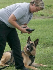 Officer Jennifer Mansfield picks up an object that