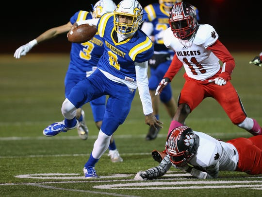 Irondequoit's Freddy June Jr. looks for room to run.