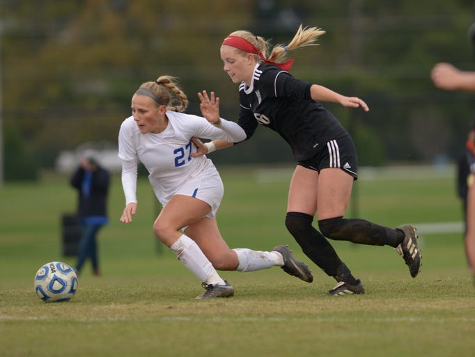 White House junior Allyson Trimmer is pushed by Greeneville