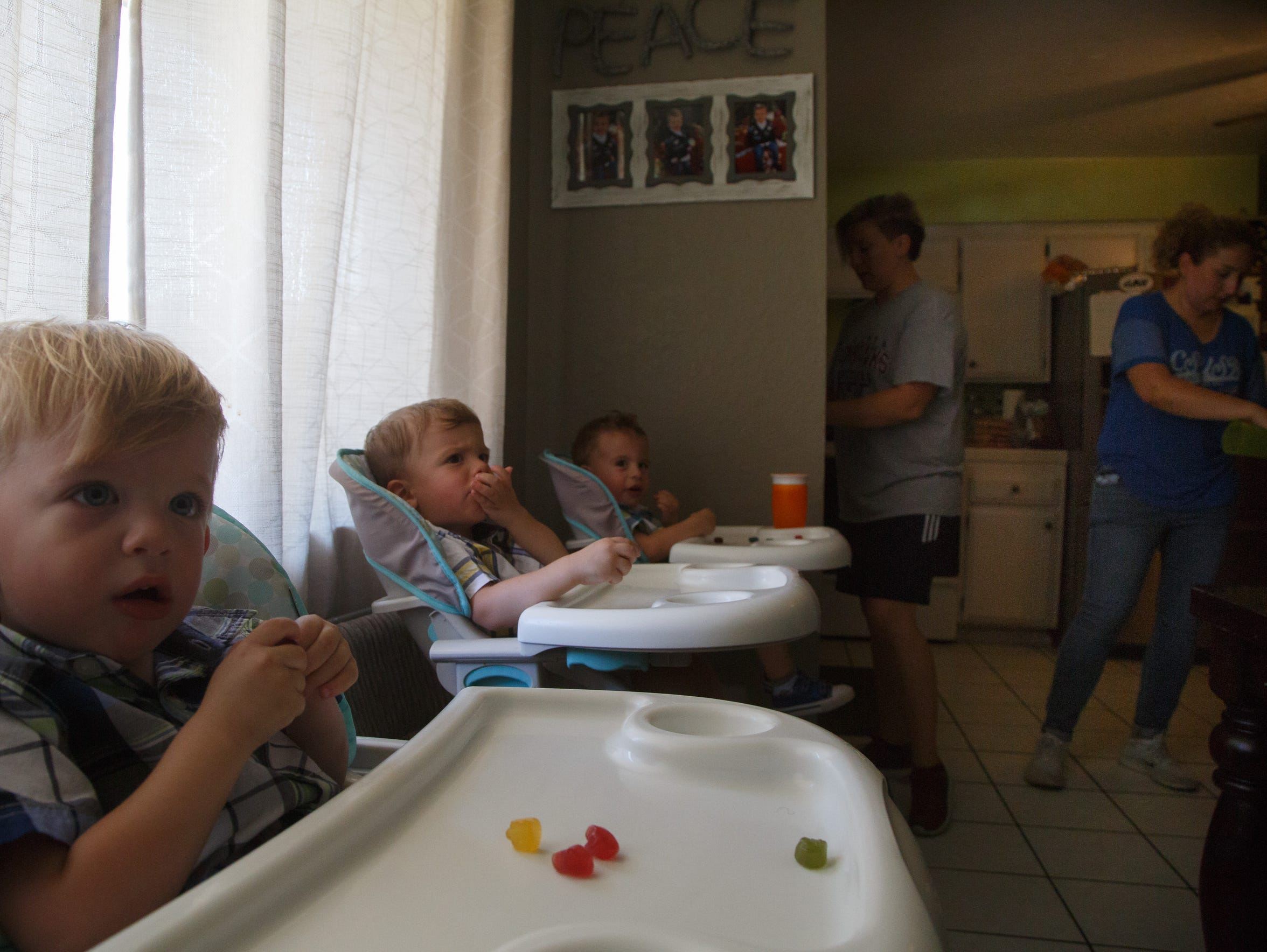 Asher, Talen and Luca Viveros, from front to back,