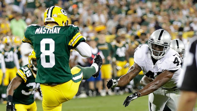 Green Bay Packers punter Tim Masthay (8) has his fourth quarter punt blocked by defensive back Brynden Trawick (41) during the game against the Oakland Raiders at Lambeau Field. The punt was recovered for a touchdown.