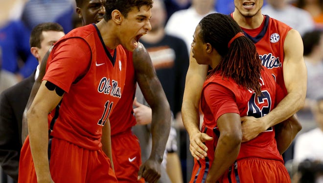 Mississippi guard Stefan Moody, front right, celebrates with Mississippi forwards Sebastian Saiz (11) and Anthony Perez, back right, after making a three-point shot with 2.7 seconds remaining in an NCAA college basketball game against Florida, Thursday, Feb. 12, 2015, in Gainesville, Fla. Mississippi won 62-61. (AP Photo/The Gainesville Sun, Matt Stamey)